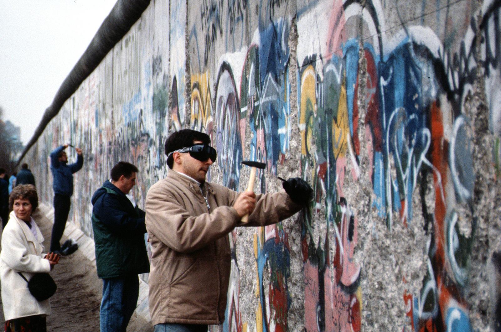 People tearing down the Berlin Wall, 1989