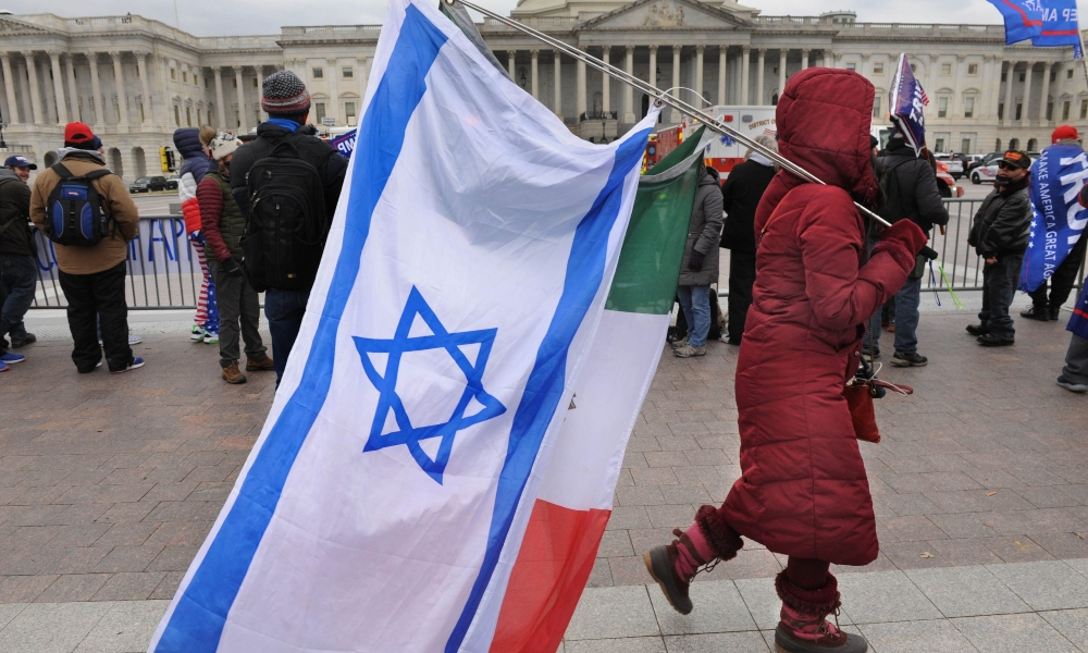 An Israeli flag carried by an insurgents in the Capitol Insurrection